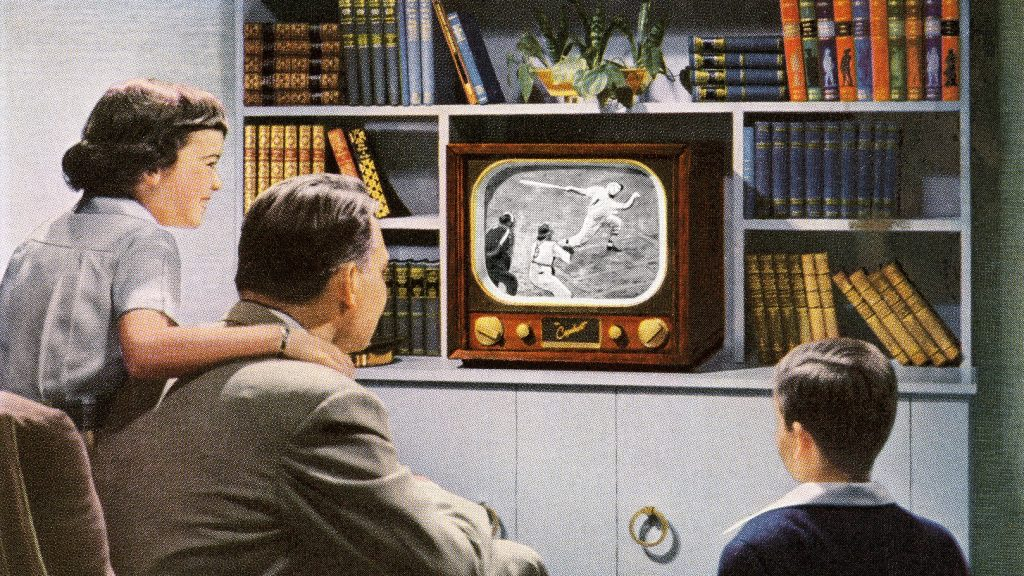 Vintage illustration of a 'modern' family watching a baseball game on their brand-new television, 1950. Screen print. (Illustration by GraphicaArtis/Getty Images)