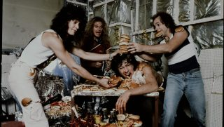 Van Halen having a crazy party eating hamburgers and potatoes, Tokyo, September 1979. (Photo by Koh Hasebe/Shinko Music/Getty Images)