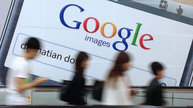 A Google page on a mobile phone is seen on an advertising billboard in Hong Kong on March 21, 2013. Eleven companies with grievances against Google urged EU antitrust regulators on Thursday to formally charge the world's No.1 search engine of anti-competitive practices instead of pursuing settlement talks. The European Commission is now examining proposals put forward by Google in January aimed at ending a two-year investigation and averting a possible fine that could reach $5 billion or 10 percent of the company's 2012 revenues. (EyePress/Harry Wong)