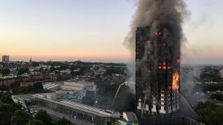 """This handout image received by local resident Natalie Oxford early on June 14, 2017 shows flames and smoke coming from a 27-storey block of flats after a fire broke out in west London. The fire brigade said 40 fire engines and 200 firefighters had been called to the blaze in Grenfell Tower, which has 120 flats. / AFP PHOTO / Natalie Oxford / Natalie OXFORD / -----EDITORS NOTE --- RESTRICTED TO EDITORIAL USE - MANDATORY CREDIT """"AFP PHOTO / Natalie Oxford"""" - NO MARKETING - NO ADVERTISING CAMPAIGNS - DISTRIBUTED AS A SERVICE TO CLIENTS - NO ARCHIVES"""