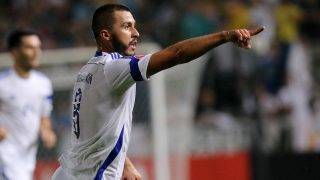 Bosnia and Herzegovina's Haris Medunjanin gestures during the Euro 2016 qualifying football match against Cyprus on October 13, 2015 in Nicosia.  AFP PHOTO / SAKIS SAVVIDES / AFP PHOTO / SAKIS SAVVIDES