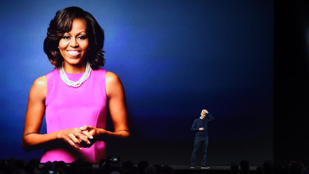 Apple CEO Tim Cook announces that former US First Lady Michelle Obama will hold a keynote address during the Apple Worldwide Developer Conference in San Jose, California, on June 5, 2017. / AFP PHOTO / Josh Edelson