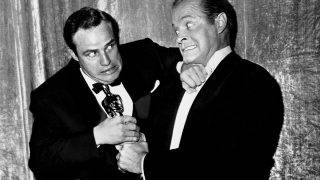 LOS ANGELES - MARCH 30:  Actor Marlon Brando wrestles his best actor Oscar away from comedian Bob Hope at the Academy Awards ceremony at the RKO Pantages Theatre on March 30, 1955 in Los Angeles, California. (Photo by Frank Worth, Courtesy of Capital Art/Getty Images)