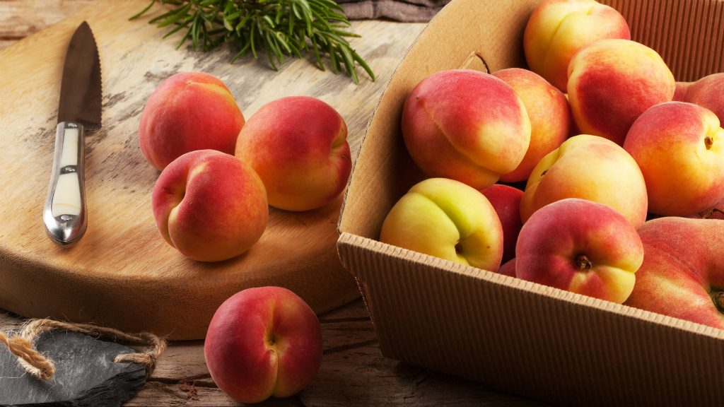 Apricots in a box and on a cutting board.