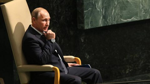 NEW YORK, NY - SEPTEMBER 28:  Russian President Vladimir Putin sits before speaking at the United Nations General Assembly at U.N. headquarters on September 28, 2015 in New York City. The ongoing war in Syria and the refugee crisis it has spawned are playing a backdrop to this years 70th annual General Assembly meeting of global leaders.  (Photo by Spencer Platt/Getty Images)