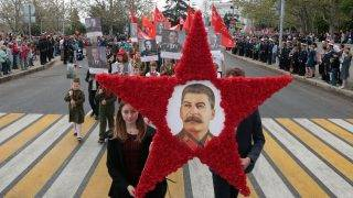 People carry portraits of late Soviet leader Joseph Stalin and World War Two soldiers during the Immortal Regiment march as they celebrate the 72nd anniversary of the Soviet Union's victory over Nazi Germany in WWII in Sevastopol, Crimea, on May 9, 2017. / AFP PHOTO / Max Vetrov