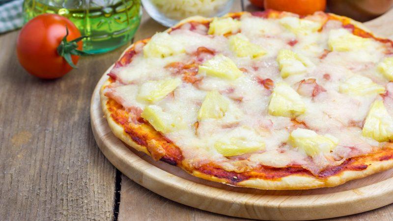 Homemade ham, bacon and pineapple Hawaii pizza