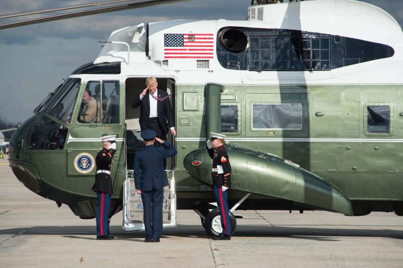 US President Donald Trump leaves Marine One before boarding Air Force One at Andrews Air Force Base in Maryland on January 26, 2017 as he departs to attend a Republican retreat in Philadelphia. / AFP PHOTO / NICHOLAS KAMM