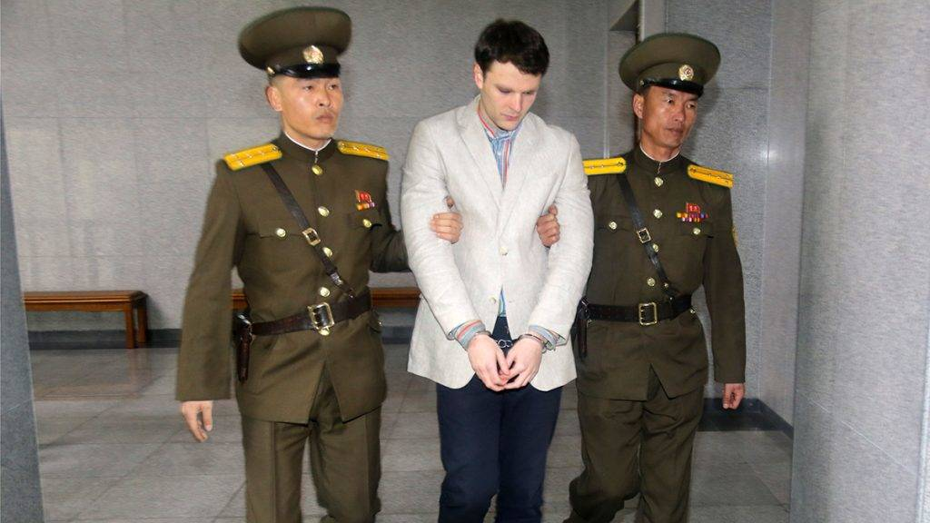 American student Otto Frederick Warmbier (C) arrives at a court for his trial in Pyongyang, capital of the Democratic People's Republic of Korea (DPRK), on March 16, 2016. American student Otto Frederick Warmbier, held by the Democratic People's Republic of Korea (DPRK), was sentenced to 15 years of hard labor for anti-DPRK crimes, the Supreme Court of the DPRK announced Wednesday. (photo: Lu Rui)