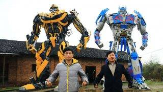 Yu Lingyun, left, and his father Yu Zhilin, both farmers, pose with Transformers models made from used car parts in front of a factory in Zhangmu town, Hengyang county, central Chinas Hunan province, 14 March 2015.  In yet another example of the limitless ingenuity of Chinese farmers, a Hunan farmer and his son have made a thriving business, raking in more than a million yuan in revenue each year by making and selling realistic model Transformers. When the Transformers films began to explode in popularity in China (the latest installment is the highest grossing film in China of all time), farmer Yu Zhilin of Zhangmu township in Hengyang county saw a promising business opportunity. With a background in the fine arts to work from, an abandoned factory to work in, used car parts and images downloaded from the internet to work with and a son to help out, he began to make some pretty incredible Transformers models. It was understandably difficult at first, according to Sina News. The first model took him three years to complete, but with experience and his son's help, he has now turned himself into the unquestioned top amateur Transformers-builder. The father and son's work attracts a constant stream of visitors and brings in a tidy profit of more than one million RMB each year. They are reportedly really excited about the next Transformers flick.