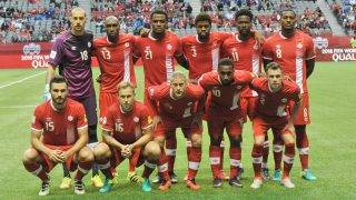 Canada's starting line-up for the World Cup 2018 football qualification match against El Salvador in Vancouver on September 6, 2016. FRONT ROW L-R:  Adam Straith #15; Scott Arfield #16; Marcel De Jong #17; Junior Hoilett #10; Nik Ledgerwood #2. BACK ROW L-R:  Milan Borjan #18; Atiba Hutchinson #13; Cyle Larin #21; Manjrekar James #3; Tosaint Ricketts #11; Doneil Henry #8.   / AFP PHOTO / Don MacKinnon