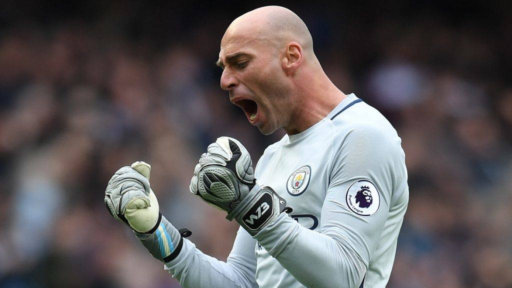 Manchester CIty's Argentinian goalkeeper Willy Caballero celebrates after Manchester City's English midfielder Raheem Sterling scored his team's fourth goal during the English Premier League football match between Manchester City and Crystal Palace at the Etihad Stadium in Manchester, north west England, on May 6, 2017. / AFP PHOTO / Paul ELLIS / RESTRICTED TO EDITORIAL USE. No use with unauthorized audio, video, data, fixture lists, club/league logos or 'live' services. Online in-match use limited to 75 images, no video emulation. No use in betting, games or single club/league/player publications.  /
