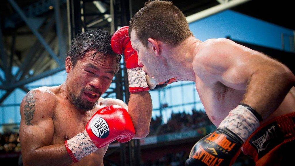 """Manny Pacquiao (L) of the Philippines fight Jeff Horn (R) of Australia during the World Boxing Organization boat at Suncorp Stadium in Brisbane on July 2, 2017.  / AFP PHOTO / Patrick HAMILTON / -- IMAGE RESTRICTED TO EDITORIAL USE - STRICTLY NO COMMERCIAL USE -- / """"The erroneous mention[s] appearing in the metadata of this photo by Patrick HAMILTON has been modified in AFP systems in the following manner: [July 2] instead of [July 1]. Please immediately remove the erroneous mention[s] from all your online services and delete it (them) from your servers. If you have been authorized by AFP to distribute it (them) to third parties, please ensure that the same actions are carried out by them. Failure to promptly comply with these instructions will entail liability on your part for any continued or post notification usage. Therefore we thank you very much for all your attention and prompt action. We are sorry for the inconvenience this notification may cause and remain at your disposal for any further information you may require."""""""