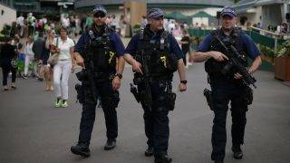 Armed British Police officers patrol at The All England Lawn Tennis Club in Wimbledon, southwest London, on July 3, 2017 on the first day of the 2017 Wimbledon Championships. / AFP PHOTO / Daniel LEAL-OLIVAS / RESTRICTED TO EDITORIAL USE