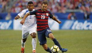 USA's Graham Zusi, right, dribbles the ball past Nicaragua's Bryan Garcia during the second half of a CONCACAF Gold Cup soccer match in Cleveland, Ohio on July 15, 2017. USA beat Nicaragua 3-0. / AFP PHOTO / Jay LaPrete