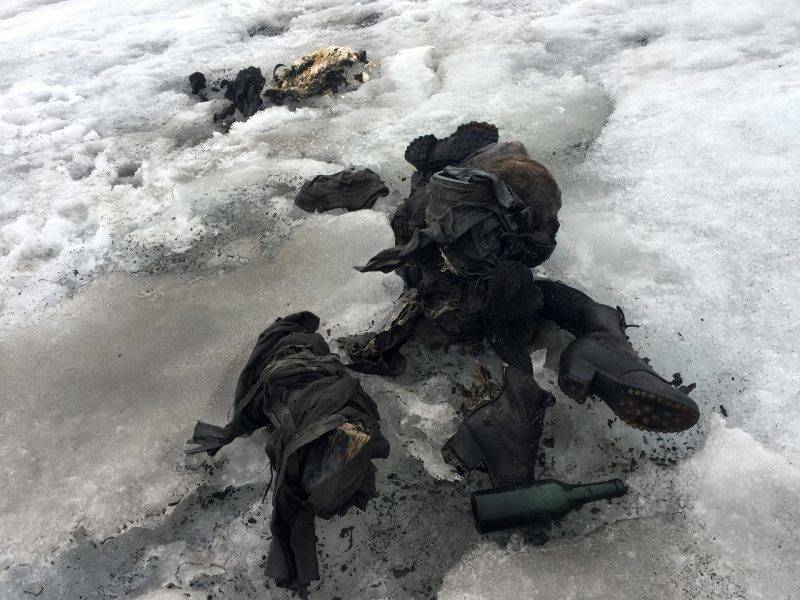 """This handout picture distributed on July 18, 2017 by the Swiss cable cars company Glacier 3000 shows the mummified remains of a Swiss Couple who went missing 75 years ago and who were found in a glacier in the Diablerets mountains, in southern Switzerland.  The perfectly preserved bodies lay close to each other, with at their side backpacks, a bottle, a book and a watch, the director of the ski area Glacier 3000, Bernard Tschannen told the daily newspaper Le Matin. An employee of the ski resort found the two frozen corpses on July 13, 2017. / AFP PHOTO / Glacier 3000 / handout / RESTRICTED TO EDITORIAL USE - MANDATORY CREDIT """"AFP PHOTO /  Glacier 3000 """" - NO MARKETING NO ADVERTISING CAMPAIGNS - DISTRIBUTED AS A SERVICE TO CLIENTS"""