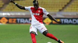 (FILES) This file photo taken on August 03, 2016 shows Monaco's Benjamin Mendy kicking the ball during the Champions League third qualifying football match between Monaco and Fenerbahce on August 3, 2016, at the Louis II stadium in Monaco.  Monaco's French full-back Benjamin Mendy has signed a five-year contract with Manchester City, the Premier League club announced on July 24, 2017. The 23-year-old, who joined Monaco from Marseille last summer, has agreed a deal with City reported to be worth a record £52 million (58 million euros) for a defender.   / AFP PHOTO / Jean-Christophe MAGNENET