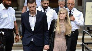 """Chris Gard (L) and Connie Yates, the parents of terminally-ill 11-month-old Charlie Gard leave the Royal Courts of Justice in London on July 24, 2017, to read a statement after they abandoned their legal fight to take their son to the US for experimental treatment. A lawyer representing Gard's parents Connie Yates and Chris Gard told judge Nicholas Francis """"time had run out"""" and they had made their decision after seeing the 11-month-old's latest brain scans.   / AFP PHOTO / CHRIS J RATCLIFFE"""