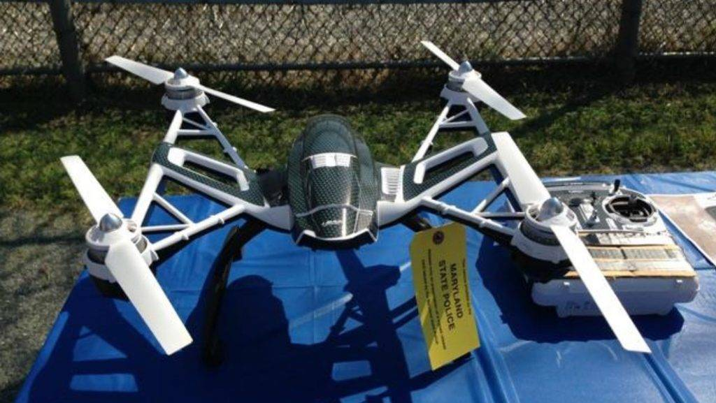 """This Image provided August 24, 2015 by the Maryland Department of Safety and Correctional Services in Towson, Maryland, shows a drone that was being used to deliver contraband into a Maryland prison.  Correctional staff and detectives from the Maryland (DPSCS) and members of the Cumberland Combined Investigative task force (C3I) have foiled what is believed to be the first case of a drone being used to deliver contraband into a Maryland prison. Two men are in custody on suspicion of trying to smuggle contraband into a prison with a drone, corrections officials said Monday. Synthetic marijuana and bootleg pornographic DVDs were among the items that the duo intended to fly into the state prison in Cumberland city.  AFP PHOTO / HANDOUT / MARYLAND DEPARTMENT OF SAFETY AND CORRECTINAL SERVICES                == RESTRICTED TO EDITORIAL USE / MANDATORY CREDIT: """"AFP PHOTO / HANDOUT / MARYLAND DSCS """"/ NO MARKETING / NO ADVERTISING CAMPAIGNS / DISTRIBUTED AS A SERVICE TO CLIENTS ==  / AFP PHOTO / Maryland DSCS / --"""
