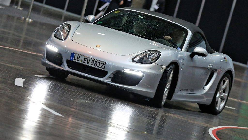The prototype of a Porsche Boxster E driving through a fair hall during a conference on electro mobility in Leipzig, Germany, 14 April 2016. Photo:Jan Woitas/dpa