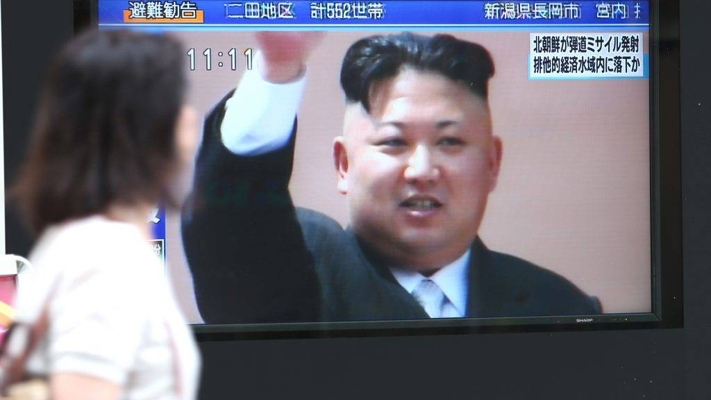 People pass by a public TV monitor screen showing a breaking news that North Korea fiired  a ballistic missile in Chiyoda Ward,  Tokyo on July 4, 2017. The missile, the 11th missile in this year, launchedd into in the waters of Japan's exlusive conomic zone. ( The Yomiuri Shimbun )
