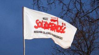 People hold a flag of Solidarnosc during the visit of the President of Poland, Andrzej Duda in Siemianowice Slaskie on March 9, 2017.  (Photo by Beata Zawrzel/NurPhoto)