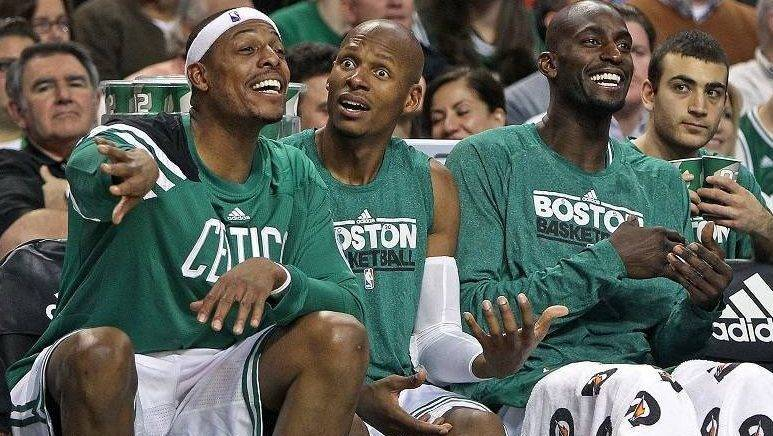12-30-11: Boston, MA: The Celtics finally broke into the win column tonight, which allowed (left to right) Paul Pierce, Ray Allen and Kevin Garnett to have some fun on the bench during the fourth quarter. The Boston Celtics hosted the Detroit Pistons in an NBA regular season game at the TD Garden, the team's home opener   (Globe Staff Photo/Jim Davis)  section:sports topic:Celtics-Pistons