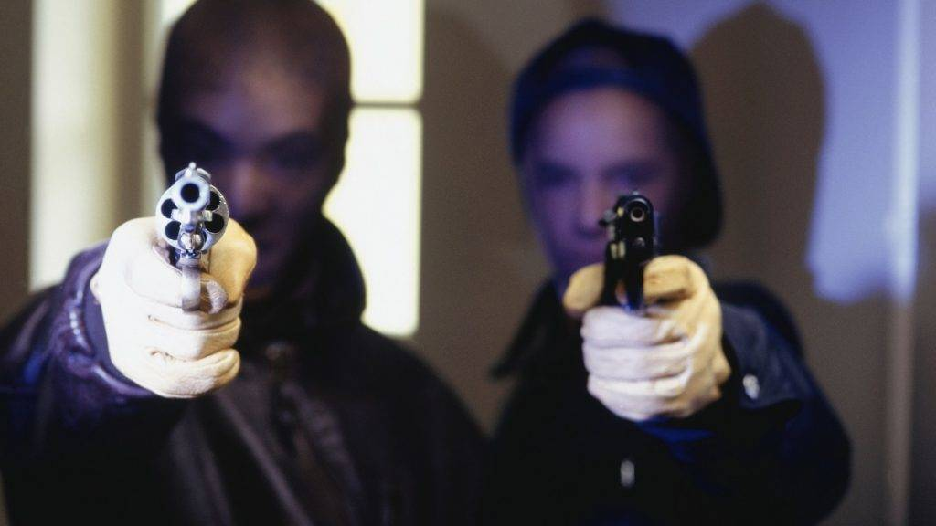 Two disguised men pointing guns, portrait