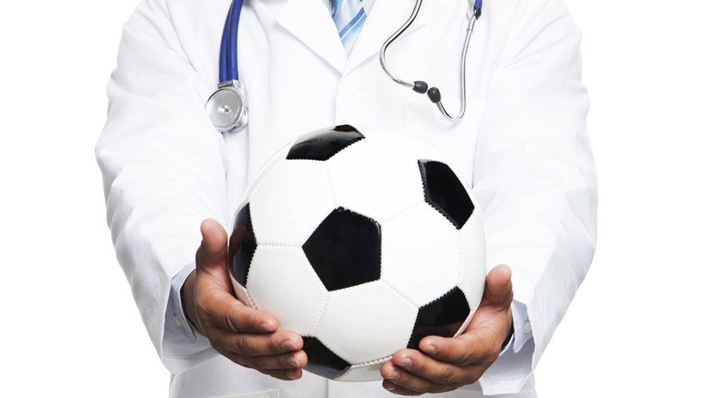 Deatail Doctor with black and white soccer ball isolated in white background..