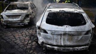 HAMBURG, GERMANY - JULY 07:  Burnt out cars in the street during the 'Welcome to Hell' anti-G20 protest march on July 7, 2017 in Hamburg, Germany. Authorities are braced for large-scale and disruptive protests as Leaders of the G20 group of nations arrive in Hamburg for the July 7-8 G20 summit.  (Photo by Alexander Koerner/Getty Images)