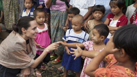 MYITKYINA, MYANMAR - JULY 30: In this handout photo provided by the Maddox Jolie-Pitt Foundation, actress and activist Angelina Jolie Pitt meets children during a visit to Ja Mai Kaung Baptist refugee camp on July 30, 2015 in Myitkyina, Myanmar. Angelina Jolie Pitt is a Special Envoy of UN High Commissioner for Refugees since her 2012 appointment.  (Photo by Tom Stoddart/Getty Images Reportage/Maddox Jolie-Pitt Foundation via Getty Images)