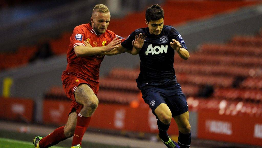 LIVERPOOL, ENGLAND - MAY 02: Ryan McLaughlin of Liverpool in action with Andreas Pereira of Manchester United during the Barclays U21 Premier League Semi Final match between Liverpool and Manchester United at Anfield on May 02, 2014 in Liverpool, England. (Photo by Chris Brunskill/Getty Images)