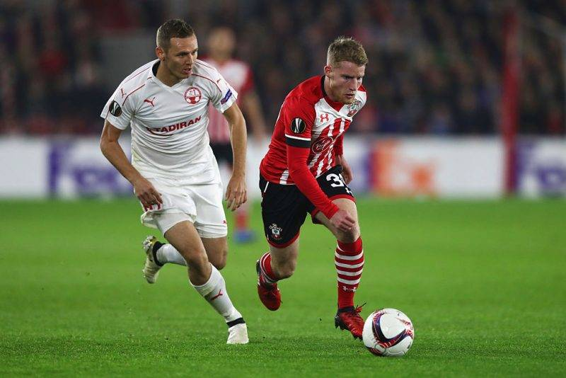 SOUTHAMPTON, ENGLAND - DECEMBER 08:  Josh Sims of Southampton is chased by Mihaly Korhut of Hapoel Be'er Sheva during the UEFA Europa League Group K match between Southampton FC and Hapoel Be'er-Sheva FC at St Mary's Stadium on December 8, 2016 in Southampton, England.  (Photo by Clive Rose/Getty Images)