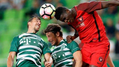 BUDAPEST, HUNGARY - JULY 13: Paul Onuachu (R) of FC Midtjylland competes for the ball in the air with Leandro De Almeida 'Leo' (L) of Ferencvarosi TC and Bence Batik (L2) of Ferencvarosi TC during the UEFA Europa League Second Qualifying Round 1st Leg match between Ferencvarosi TC and FC Midtjylland at Groupama Arena on July 13, 2017 in Budapest, Hungary. (Photo by Laszlo Szirtesi/Getty Images)