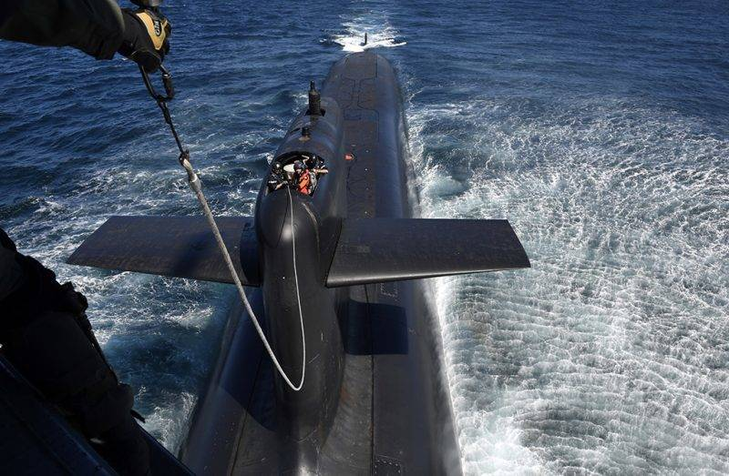 """This photograph taken at sea on July 4, 2017, shows a general view of submarine """"Le Terrible"""" during a visit by French President Emmanuel Macron to the vessel.   / AFP PHOTO / POOL / Fred TANNEAU"""