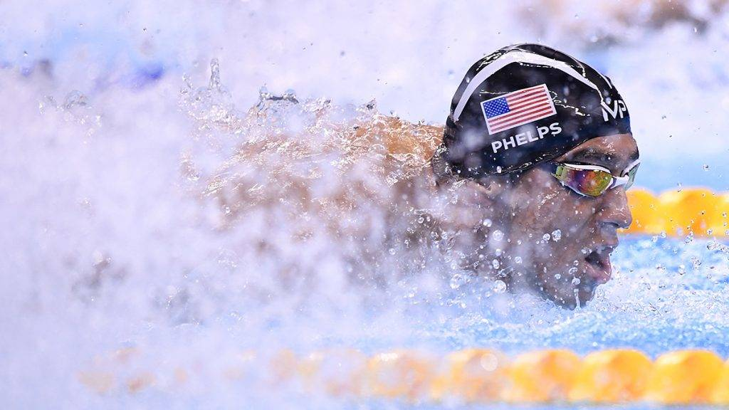 Team USA, Michael Phelps, competes in the Men's swimming 4 x 100m Medley Relay Final at the Rio 2016 Olympic Games at the Olympic Aquatics Stadium in Rio de Janeiro on August 13, 2016.   / AFP PHOTO / GABRIEL BOUYS
