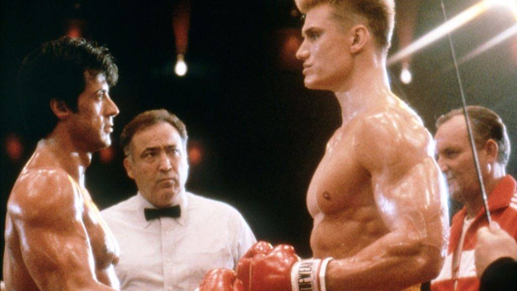 Swedish actor Dolph Lundgren with American actor, director and screenwriter Sylvester Stallone on the set of his movie Rocky IV. (Photo by Sunset Boulevard/Corbis via Getty Images)