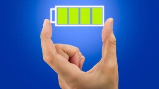 Hand showing a battery full icon .All screen content is designed by my and not copyrighted by others and created with digitizing tablet and image editor