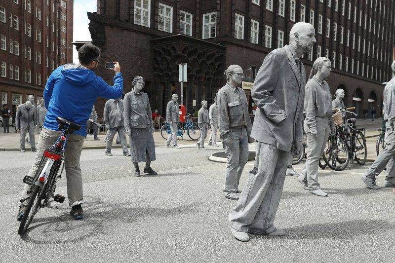 HAMBURG, GERMANY - JULY 05:  Performance artists covered in clay to look like zombies walk trance-like through the city center during a preliminary performance on July 5, 2017 in Hamburg, Germany. In a two-hour show hundreds of actors took part in a creative public appeal for more humanity and self-responsibility ahead of the upcoming G20 summit. The G20 economic summit takes place in Hamburg July 7-8.  (Photo by Sean Gallup/Getty Images)