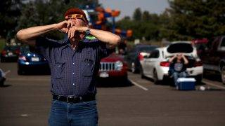 "CASPER, WY - AUGUST 21: A visitor looks at the solar eclipse at South Mike Sedar Park on August 21, 2017 in Casper, Wyoming. Millions of people have flocked to areas of the U.S. that are in the ""path of totality"" in order to experience a total solar eclipse. During the event, the moon will pass in between the sun and the Earth, appearing to block the sun.   Justin Sullivan/Getty Images/AFP"