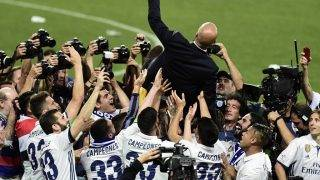 Real Madrid's French coach Zinedine Zidane is tossed in the air by players as they celebrate winning the Liga title after the Spanish league football match Malaga CF vs Real Madrid CF  at La Rosaleda stadium in Malaga on May 21, 2017. / AFP PHOTO / JOSE JORDAN