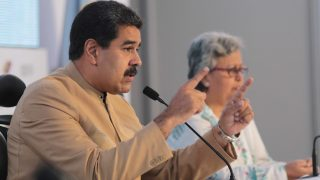 """Handout picture released by the presidency of Venezuelan President Nicolas Maduro (L) talking along the head of Venezuela's National Electoral Council (CNE) Tibisay Lucena during a meeting in Caracas on July 31, 2017. Venezuela's attorney general Luisa Ortega, a vocal dissenter in President Nicolas Maduro's government, said Monday she will not recognize a new assembly voted in on the weekend, calling it an expression of """"dictatorial ambition."""" / AFP PHOTO / Presidency / HO / RESTRICTED TO EDITORIAL USE - MANDATORY CREDIT """"AFP PHOTO /PRESIDENCY"""" - NO MARKETING NO ADVERTISING CAMPAIGNS - DISTRIBUTED AS A SERVICE TO CLIENTS"""
