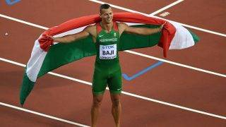 Hungary's Balázs Baji celebrates taking the bronze medal in the final of the men's 110m hurdles athletics event at the 2017 IAAF World Championships at the London Stadium in London on August 7, 2017. / AFP PHOTO / ANTONIN THUILLIER