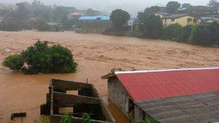 """This handout picture released on August 14, 2017, by Society 4 Climate Chnage Communication Sierra Leone, shows flooded streets in Regent near Freetown. The death toll from massive flooding in the Sierra Leone capital of Freetown climbed to 312 on August 14, 2017, the local Red Cross told AFP. Red Cross spokesman Patrick Massaquoi told AFP the toll could rise further as his team continued to survey disaster areas in Freetown, where heavy rains have caused homes to disappear under water and triggered a mudslide.  / AFP PHOTO / Society 4 climate change communication Sierra Leone / STR / RESTRICTED TO EDITORIAL USE - MANDATORY CREDIT """"AFP PHOTO / """"S4CCC-SL"""" - NO MARKETING NO ADVERTISING CAMPAIGNS - DISTRIBUTED AS A SERVICE TO CLIENTS"""