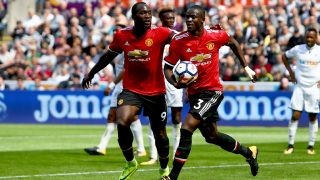 Manchester United's Ivorian defender Eric Bailly (R) celebrates with Manchester United's Belgian striker Romelu Lukaku scoring the team's first goal during the English Premier League football match between Swansea City and Manchester United at The Liberty Stadium in Swansea, south Wales on August 19, 2017. / AFP PHOTO / Geoff CADDICK / RESTRICTED TO EDITORIAL USE. No use with unauthorized audio, video, data, fixture lists, club/league logos or 'live' services. Online in-match use limited to 75 images, no video emulation. No use in betting, games or single club/league/player publications.  /