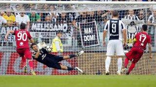 Juventus' goalkeeper Gianluigi Buffon saves a penalty kick  during the Italian Serie A football match Juventus vs Cagliari on August 19, 2017 at the Allianz Stadium in Turin. / AFP PHOTO / Marco BERTORELLO