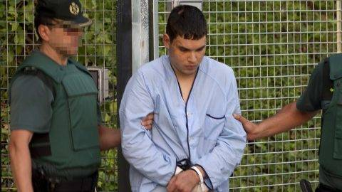 Mohamed Houli Chemlal, suspected of involvement in the terror cell that carried out twin attacks in Spain, is escorded by Spanish Civil Guards from a detention center in Tres Cantos, near Madrid, on August 22, 2017 before being tranferred to the. National Court Under heavy security, police vans entered the National Court, which deals with terrorism cases, where a judge will question them and decide what -- if any -- charges to press against them over the vehicle attacks that left 15 dead and 120 injured. / AFP PHOTO / STRINGER