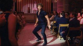 Dirty Dancing  Year : 1987 USA Director : Emile Ardolino Jennifer Grey, Patrick Swayze. It is forbidden to reproduce the photograph out of context of the promotion of the film. It must be credited to the Film Company and/or the photographer assigned by or authorized by/allowed on the set by the Film Company. Restricted to Editorial Use. Photo12 does not grant publicity rights of the persons represented.