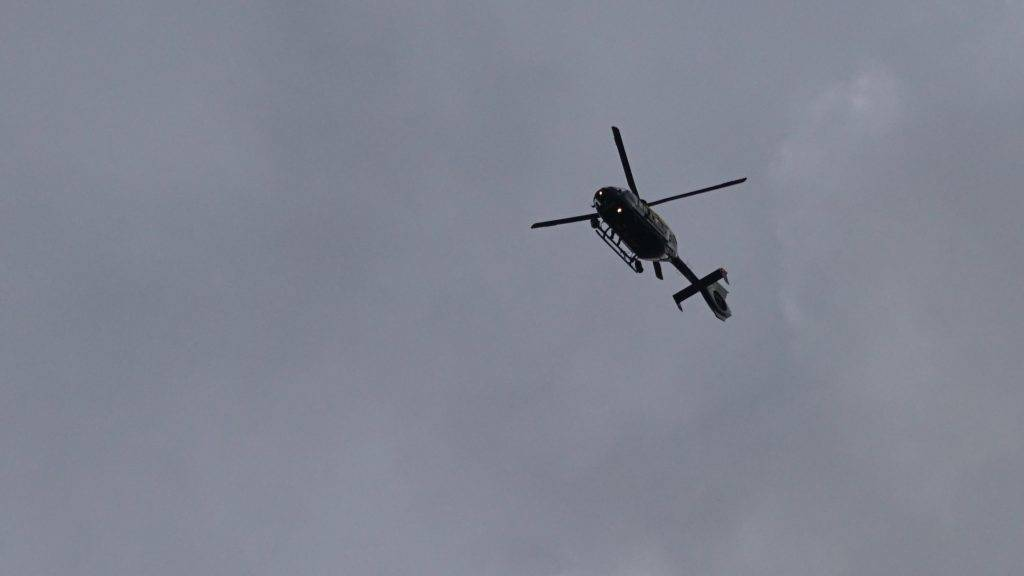 UNITED Kingdom, London: A helicopter flies above Westminster after shots were fired outside Parliament and a car rammed into members of the public on Westminster Bridge on March 22, 2017 in London. - See LI