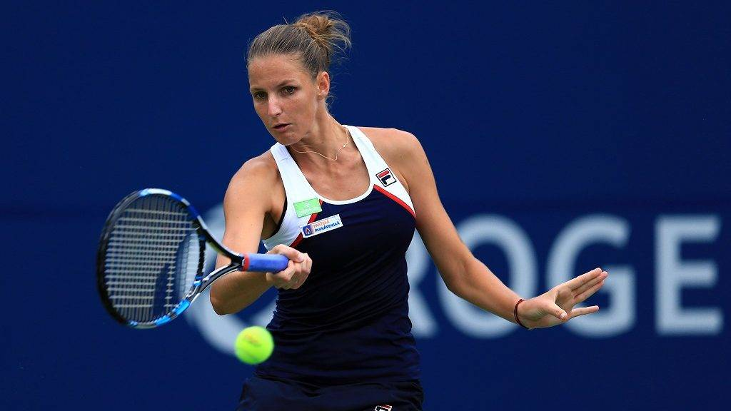 TORONTO, ON - AUGUST 11: Karolina Pliskova of Czech Republic hits a shot against Caroline Wozniacki of Denmark during Day 7 of the Rogers Cup at Aviva Centre on August 11, 2017 in Toronto, Canada.   Vaughn Ridley/Getty Images/AFP